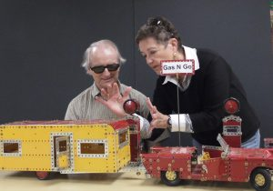 """Charlie Pack and Jane working on """"By Hand"""" extension exhibit, Nov 2011."""
