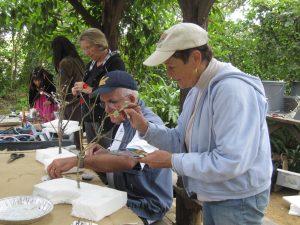 "Jane & John Reed, make trees for Riveropolis display, ""Shaped by Water"" exhibit, 10/10/11."