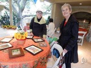Jane and Emily Hollinger set up artwork, Geshke Garden Gala, May 7, 2016.